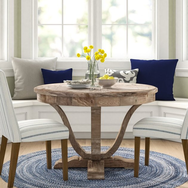 reclaimed wood pedestal farmhouse table idea near bay window