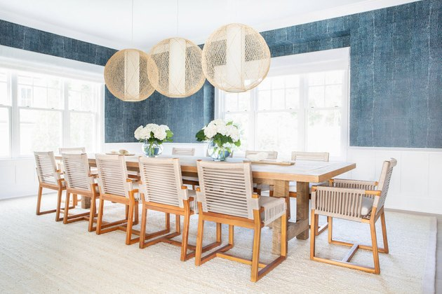 Dining room wainscoting with blue wallpaper above by Chango & Co.
