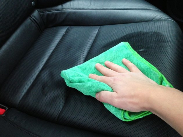Cleaning leather car seat.