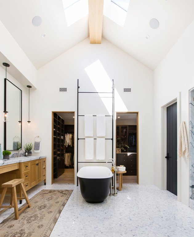 farmhouse bathroom with vaulted ceiling and marble mosaic floor tile