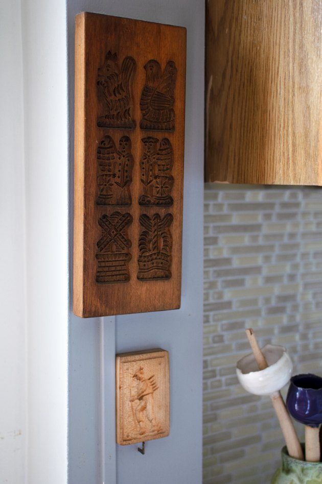 wood pieces hanging on the wall near kitchen space