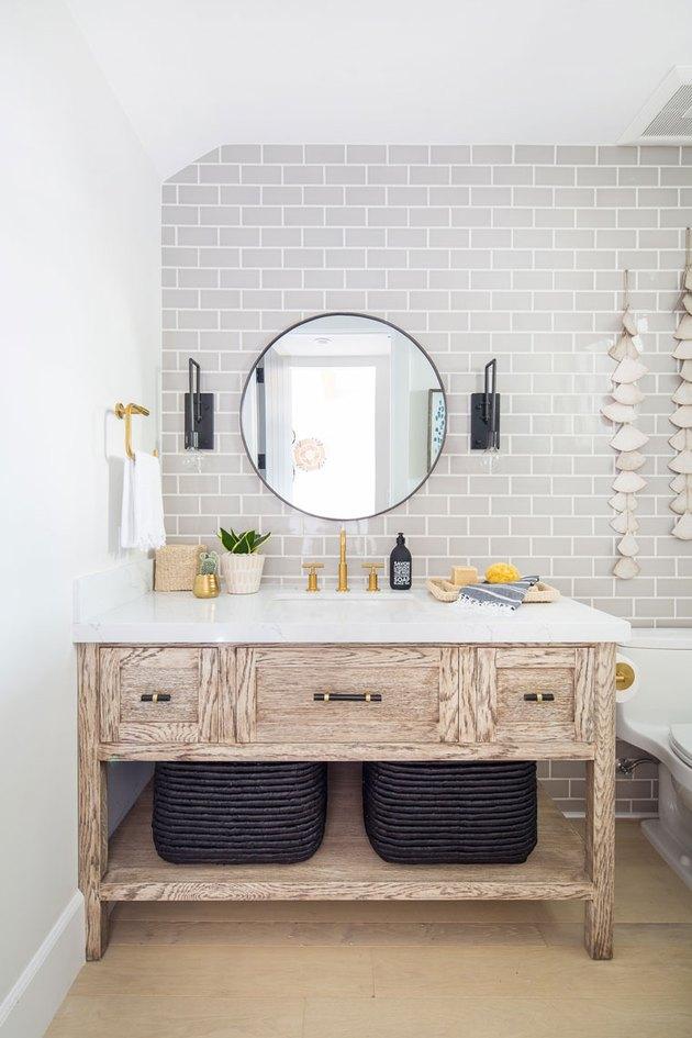 half bathroom idea with gray subway tile and wood vanity cabinet