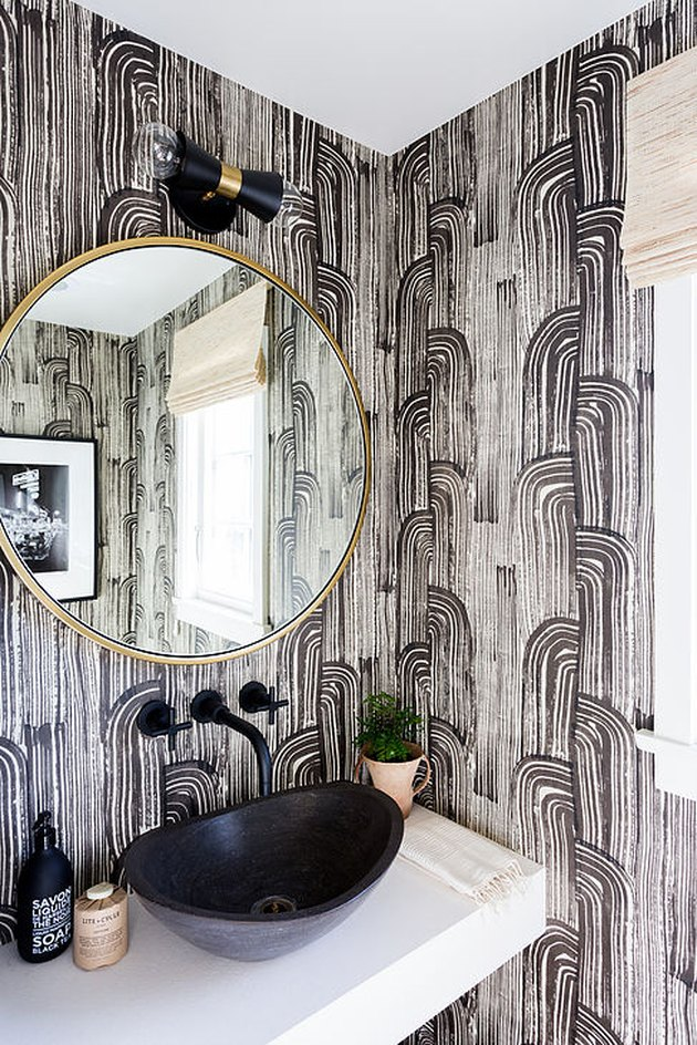half bathroom idea with patterned wallpaper and bowl sink