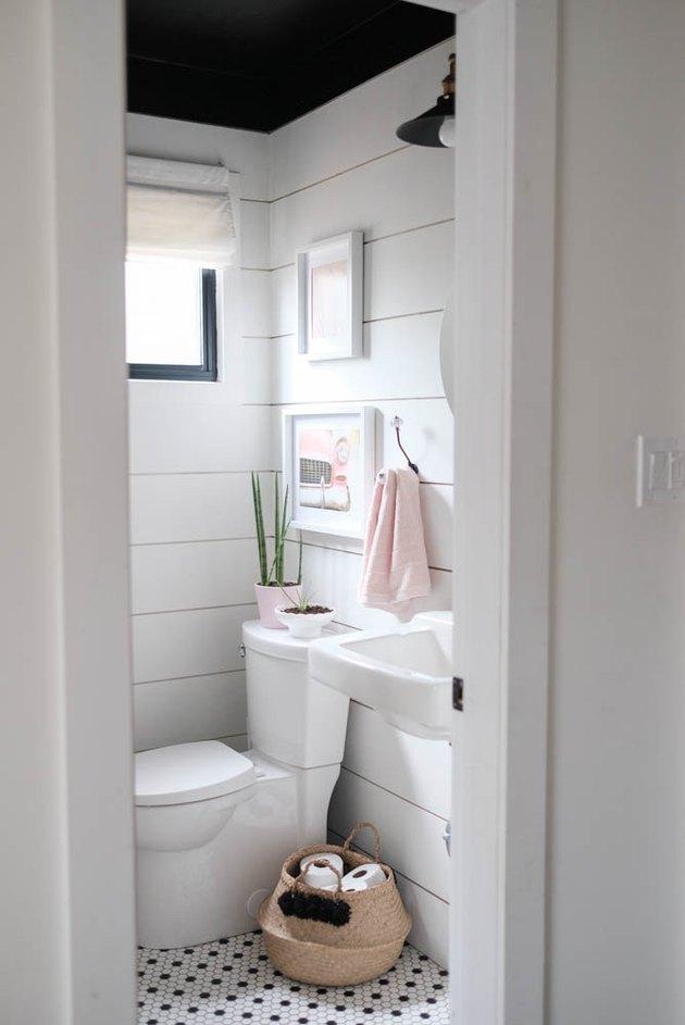 farmhouse bathroom with shiplap walls and black ceiling