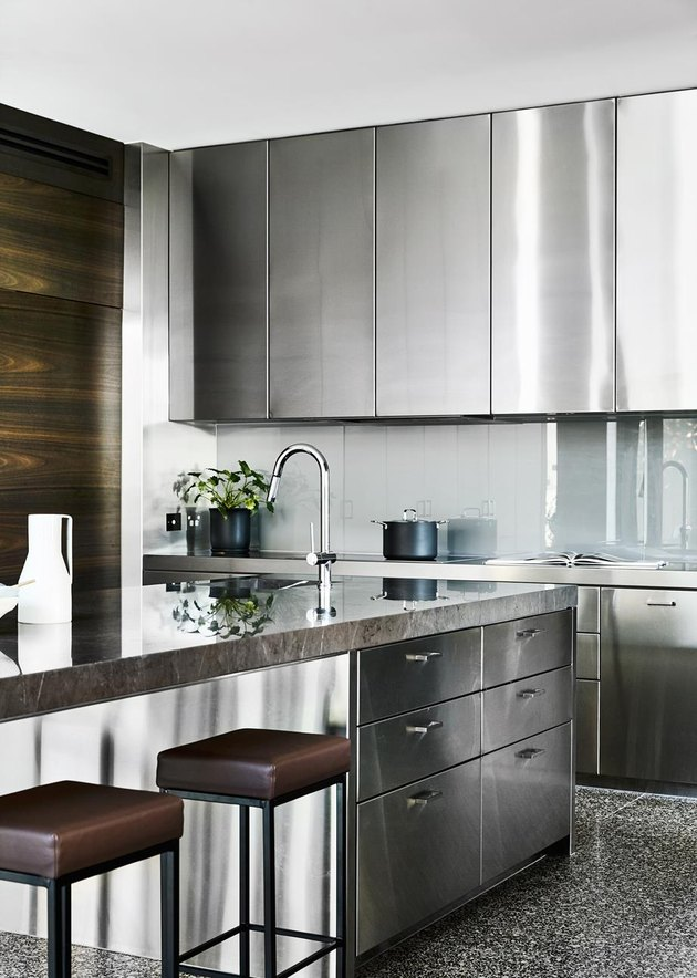 stainless steel kitchen cabinets against walnut