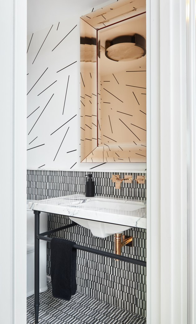 half bathroom idea with multiple patterns console sink