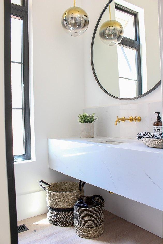white half bathroom idea with black trim