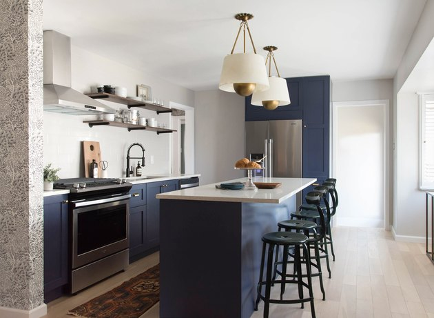 navy blue kitchen color idea with cabinets and island and black stools