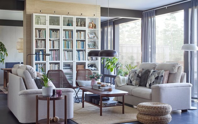 living room space with white shelves and beige couches