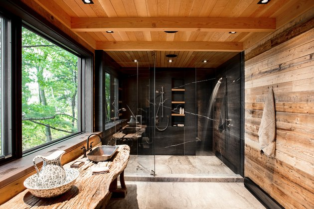 Rustic shower idea with modern accents, wood planks, and black slate walls