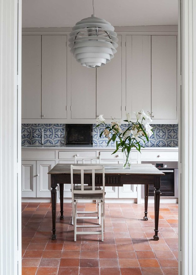 French country dining room in kitchen with Terracottas Floors by Coco Kelley