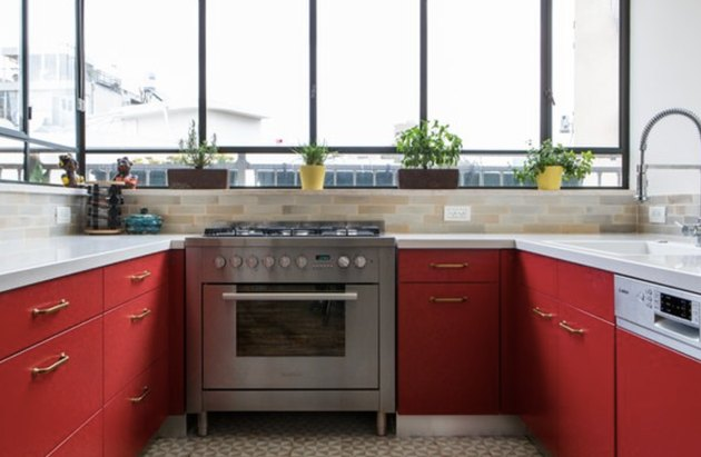 Red lower cabinets allow for a stylish kitchen that's also functional.