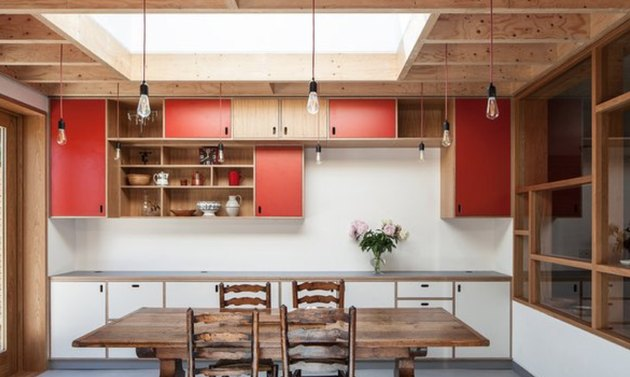 Add a few red cabinet doors to an otherwise neutral kitchen.