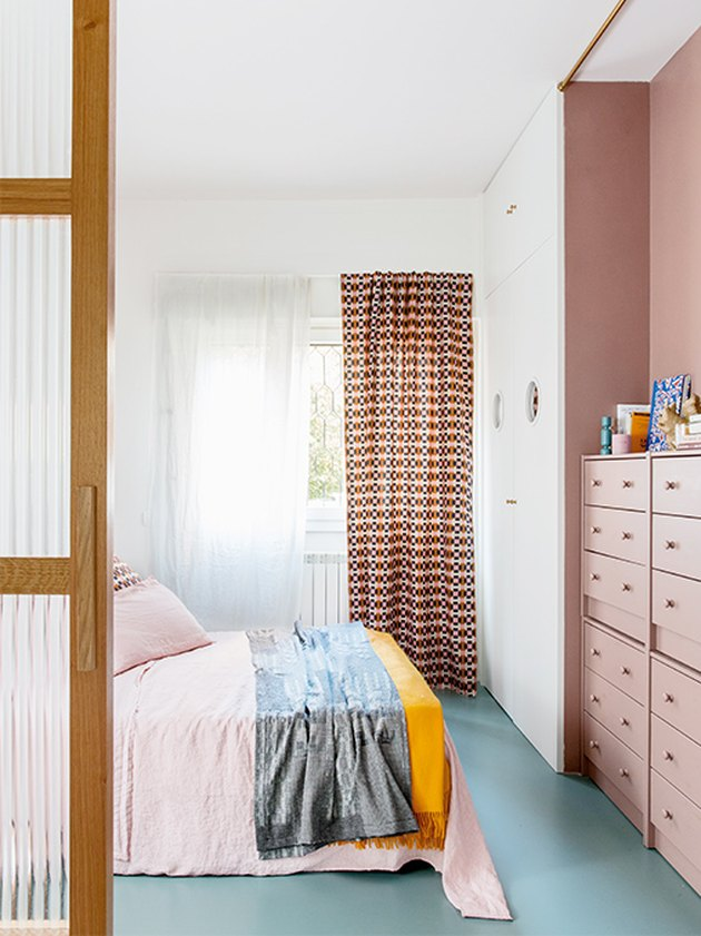 bedroom with pink walls and blue floors