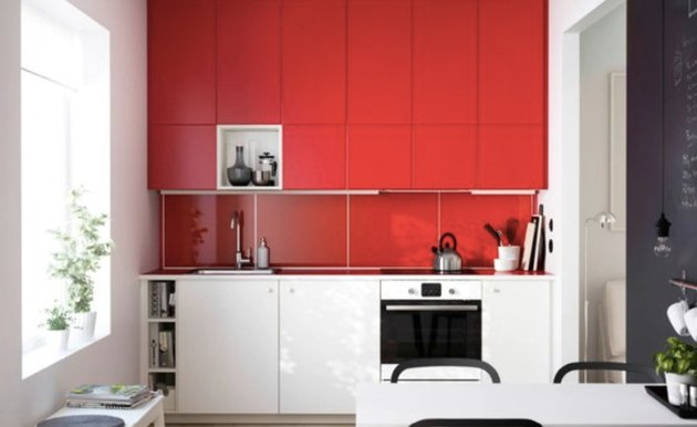 Glossy red painted kitchen cabinets with white lover cabinets.
