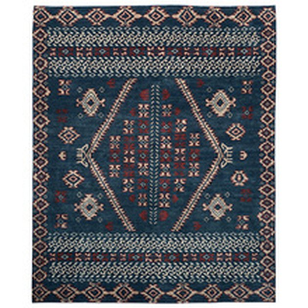 Navy blue-dominant variegated rug with cream and maroon accents