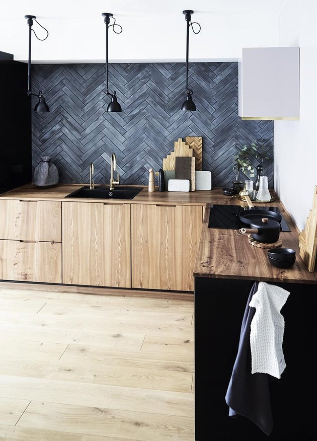 black slate backsplash in herringbone pattern