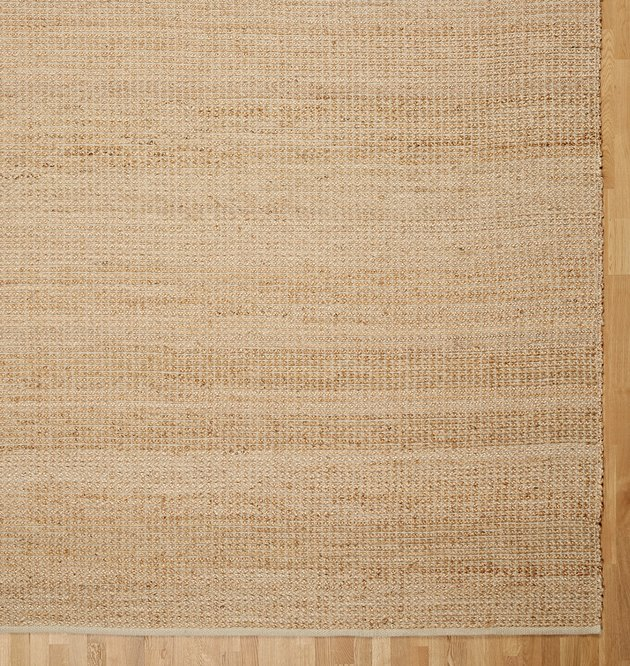 Beige woven layering rug