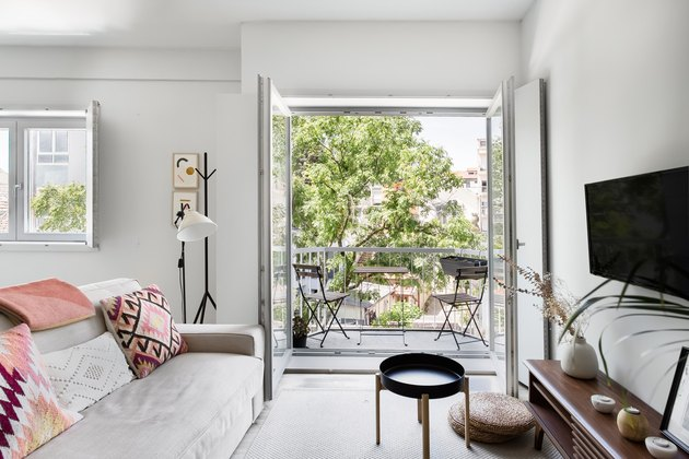 living room space with doors open to balcony area
