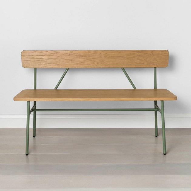 light wood bench with green metal legs