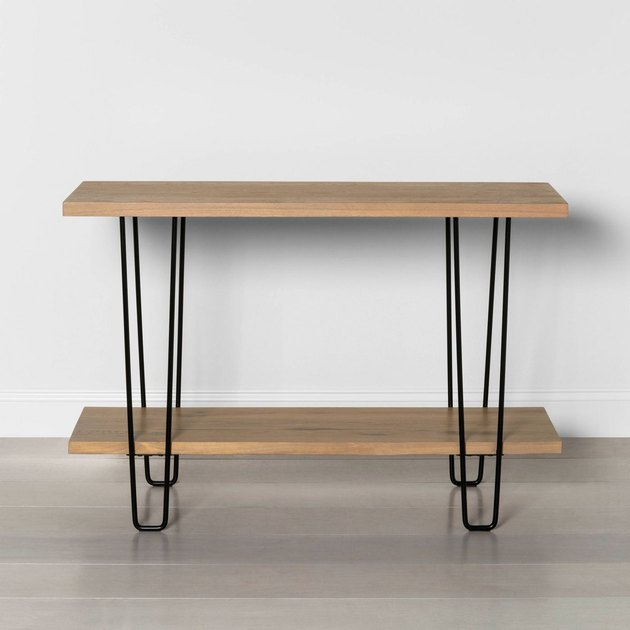 light wood media console with black hairpin legs