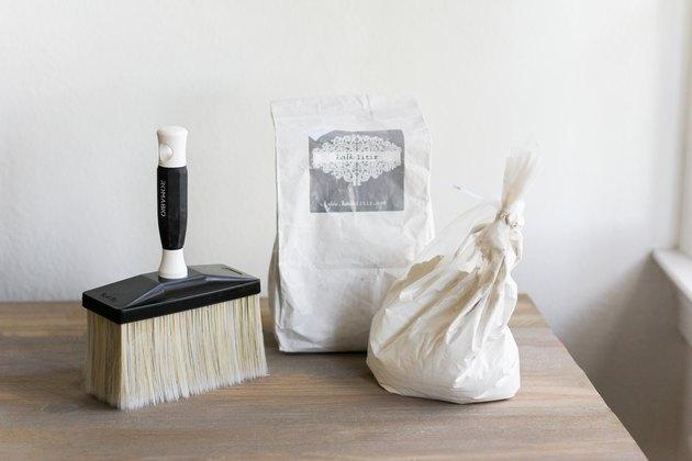 Limewash powder and masonry brush