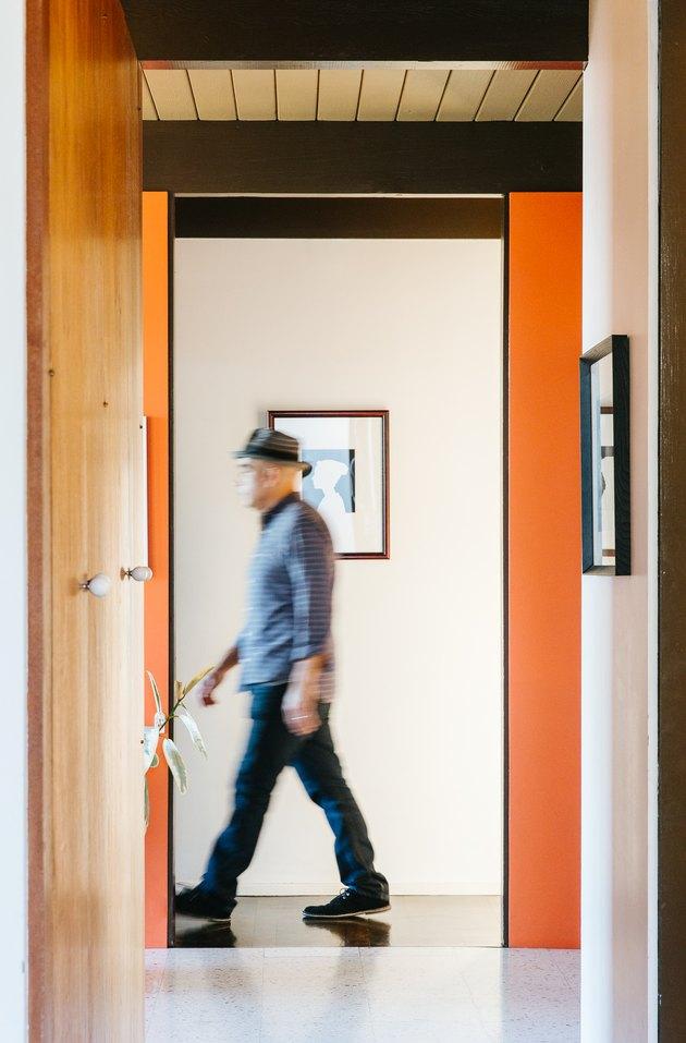 Hallway with wood and orange walls