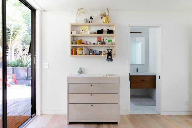 floor-to-ceiling windows and view of diaper changing table and hardwood floors