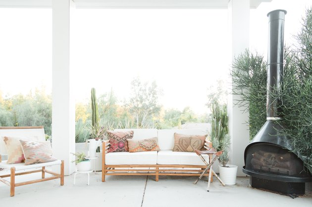 patio with sofa and outdoor fireplace