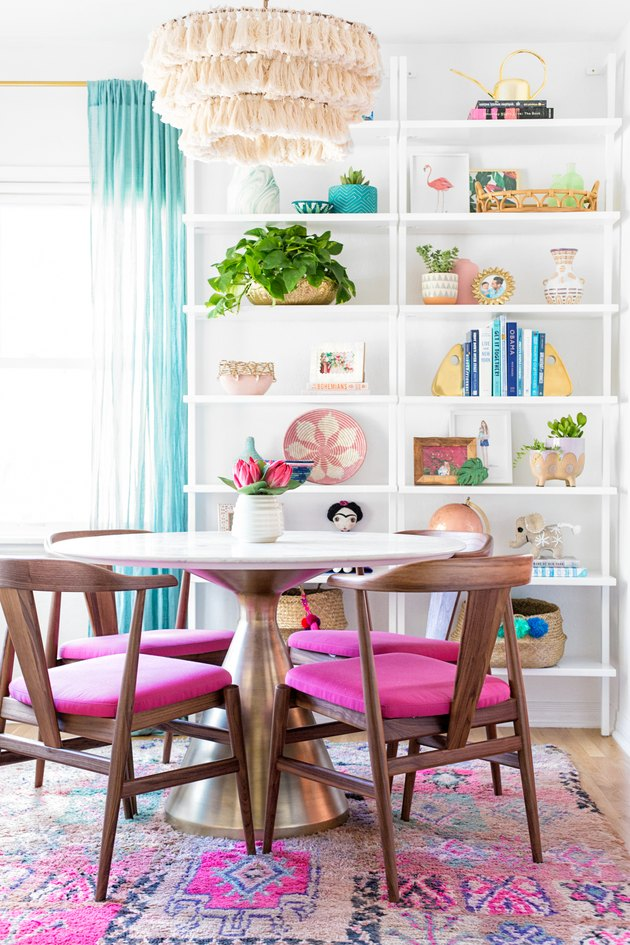 colorful dining room with bohemian tassel pendant light and white open shelving