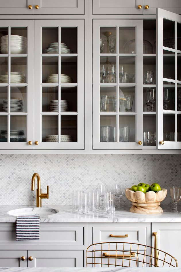 gray backsplash kitchen idea with mosaic tile and gray cabinets
