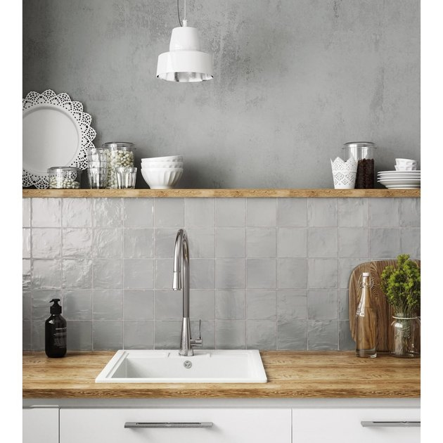 gray backsplash kitchen idea with square tile and wood countertops