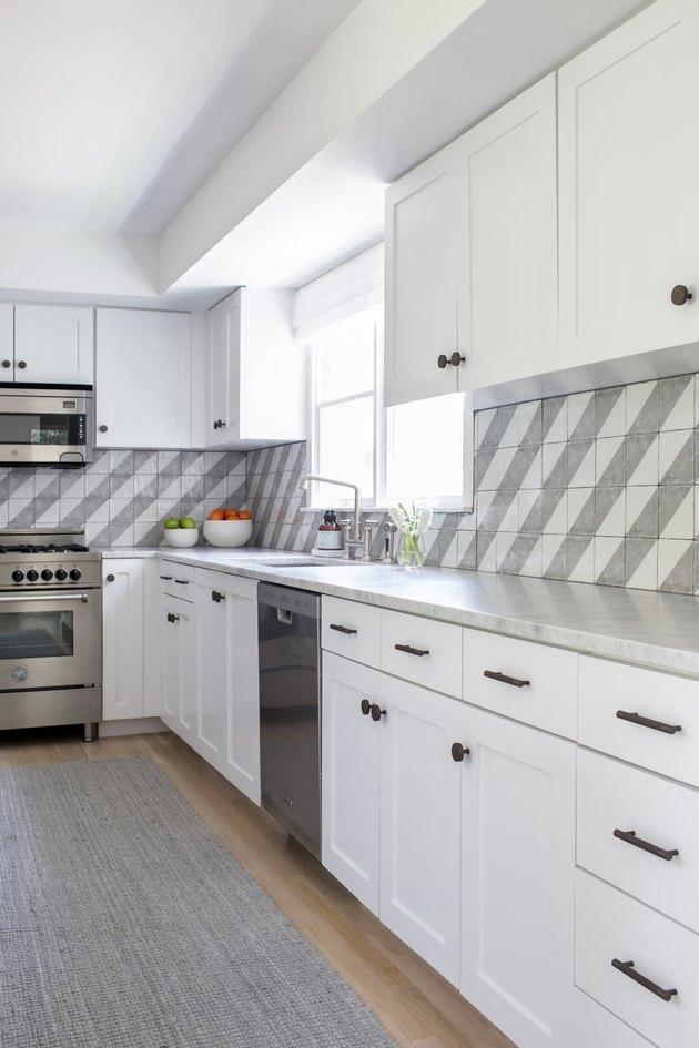 Gray Backsplash Kitchen Idea by Chango & Co.