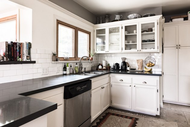 kitchen with white cabinets and kitchenware on top
