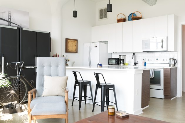 kitchen with white cabinets with baskets atop them