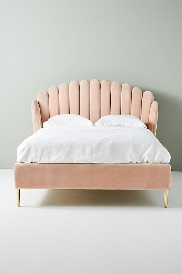 blush bed with white sheets