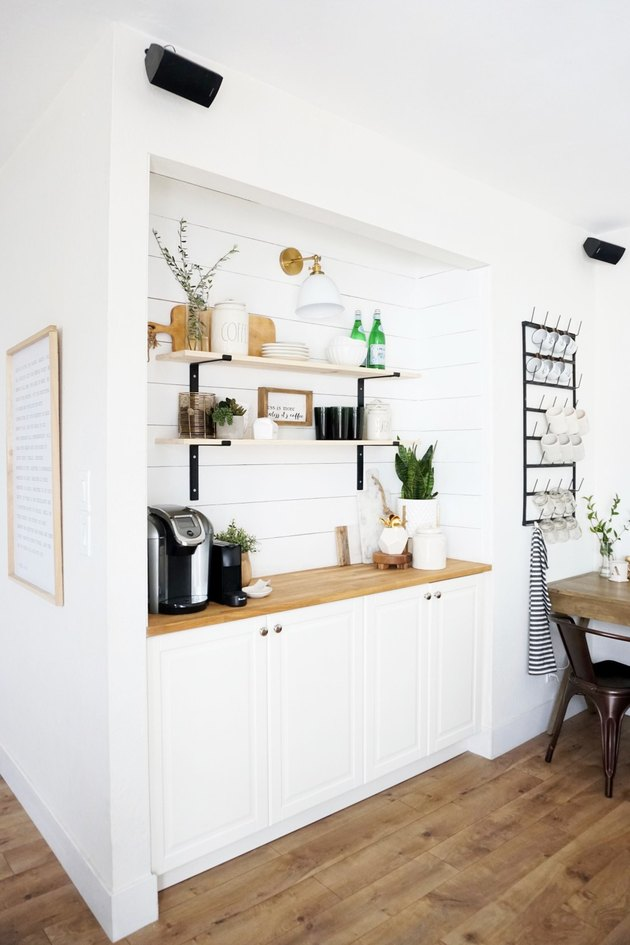Farmhouse coffee bar with white shiplap and white cabinets in family room