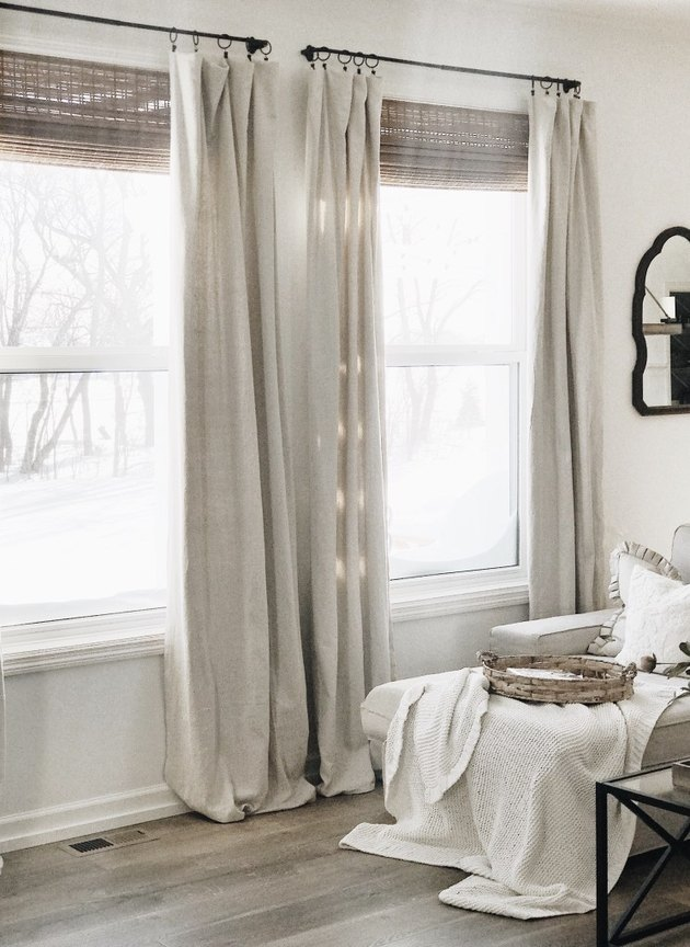 farmhouse DIY idea with no-sew drop cloth curtains in beige in white farmhouse living room