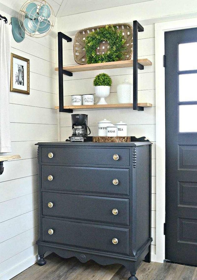 Farmhouse coffee bar with navy blue dresser and open shelving