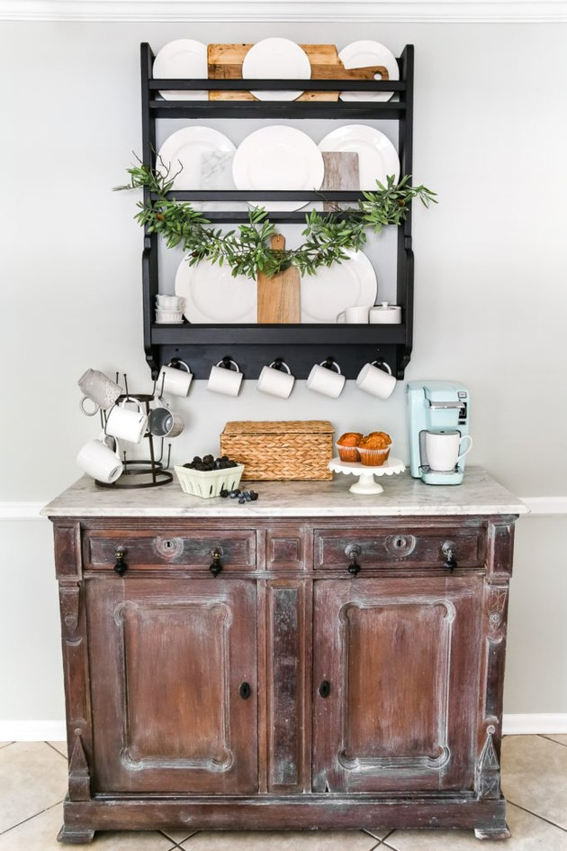 Farmhouse coffee bar with vintage cabinet and white dinnerware