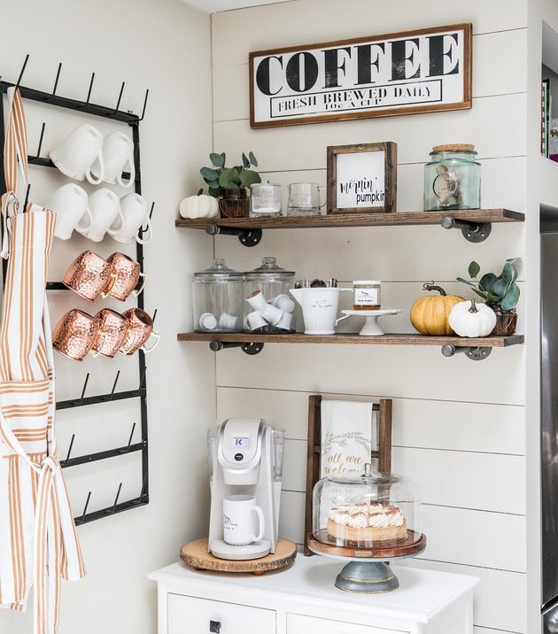 Farmhouse coffee bar in small corner with mug rack and white shiplap