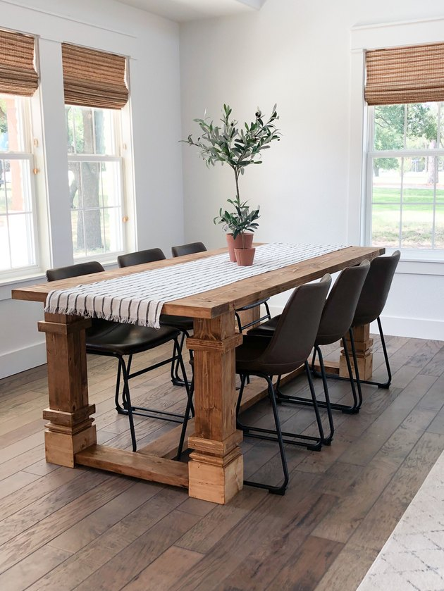modern farmhouse DIY idea wood dining table with black chairs and table runner