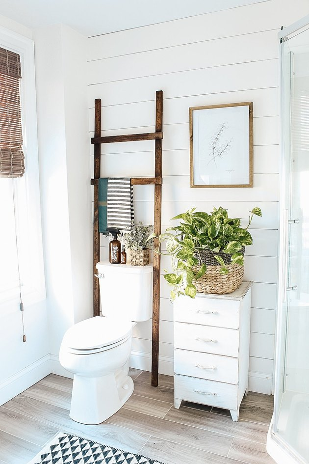 farmhouse DIY idea with wood bathroom ladder in white farmhouse bathroom