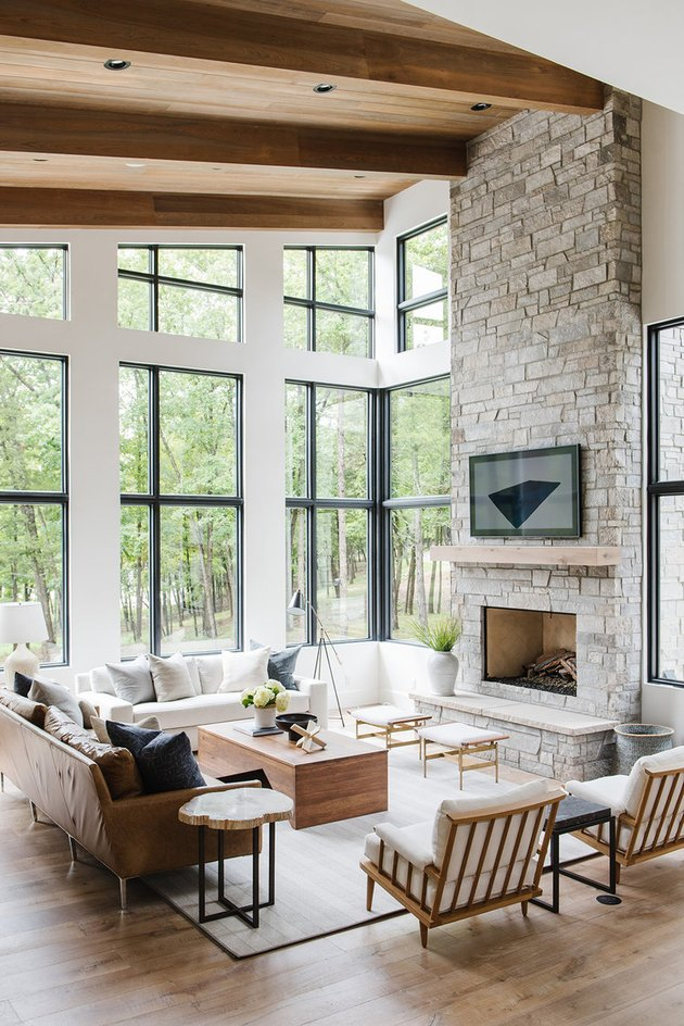 rustic living room idea with wood beams and stone fireplace