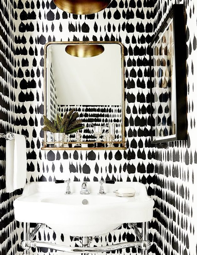Schumacher's Queen of Spain wallpaper in bathroom with white sink.