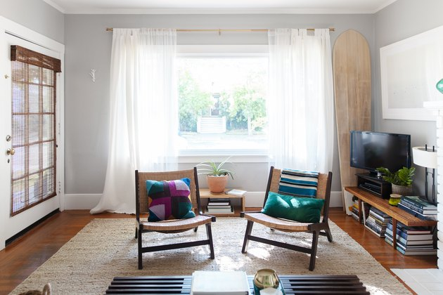 living room with two chairs in front of open window with sheer drapery