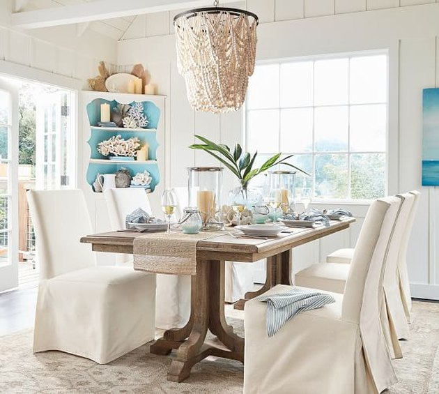 coastal dining room lighting with Pottery Barn amelia wood bead chandelier