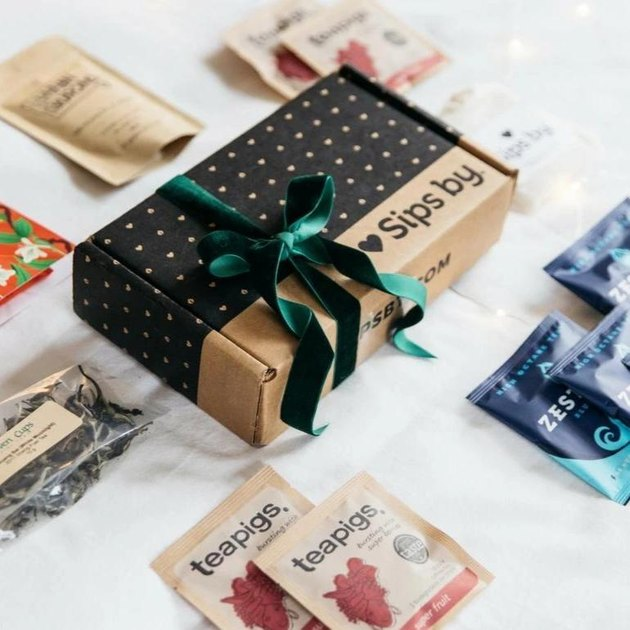 tea subscription box with green bow and bags of tea