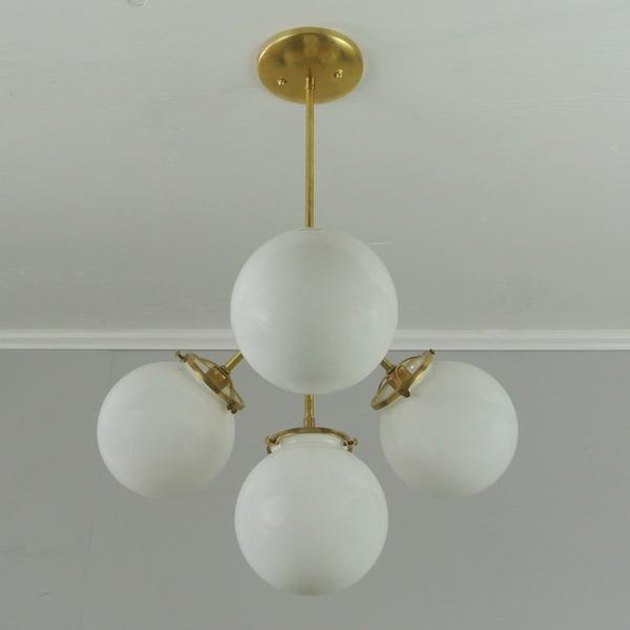 Glass globe chandelier/pendant with four white globes and brass details