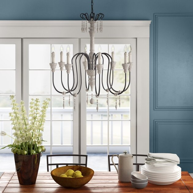 slim metal candelabra style chandelier with wood accents